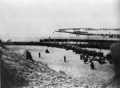 Defeated British and French troops waiting on the dunes at Dunkirk to be picked up by the Destroyers and taken back to England. (Photo by Topical Press Agency/Getty Images)